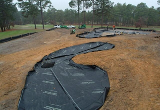 golf course drainage system, Agronomic, drainage, golf course bunker, tee boxes, golf greens, sub-surface, natural turf, sand profile, USGA, usga drainage, swale, bio swale, sand traps, bunker drainage, water retention, perched water table, water reuse, storm water management, cad details, drainage layer, synthetic drainage layer, sand based field, sand based profile, golf drainage, golf greens, greens, airdrain, putting green, putting green drainage, golf green drainage, golf green construction, perched water table, fairway drainage, golf construction, golf, golf course construction, practice greens, golf drainage, golf course drainage, water drainage, sand bunker drainage, tee box drainage, airgrid, air grid, bunker drainage systems